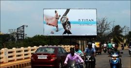 Titan presents its 'wedding gift' on large billboards
