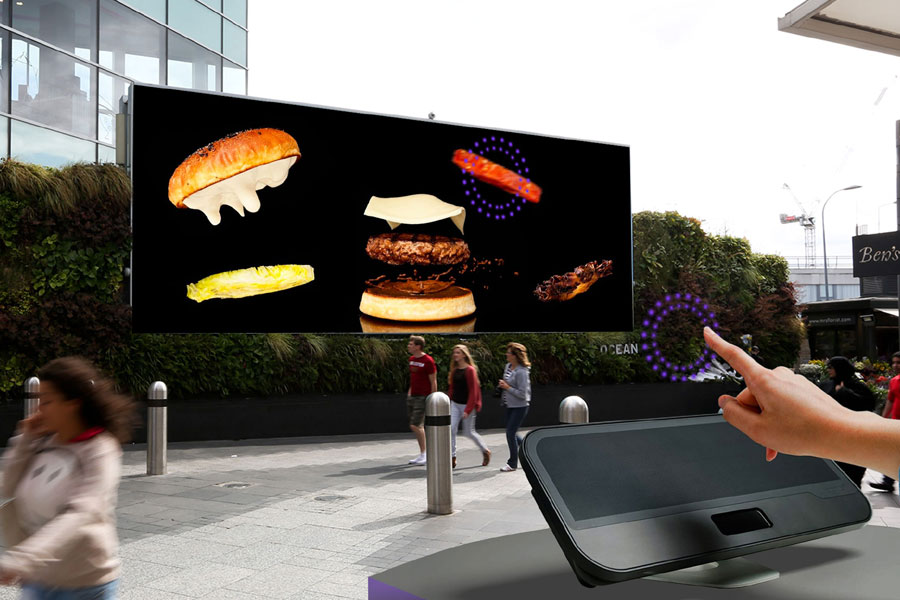 Concept: customers are invited to pick ingredients for custom burgers via Ocean's screens using mid-air haptics tech.  Once they have finished creating their burger, the retailer displays a QR code on the screen unique to that burger which customers can redeem in the relevant nearby outlet.